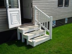 3 tread step unit with spindled hand rail.jpg