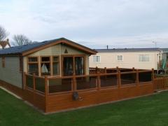 Holiday home deck golden oak balustrade antique oak board caravan glass panels decking upvc plastic low maintenance