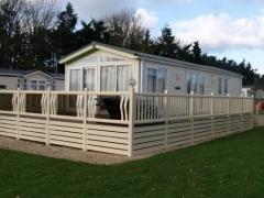 Holiday home decking cream bronze glass caravan park estate lodge upvc plastic skirting ranch style fensys