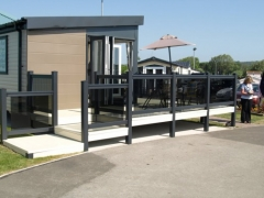 Holiday home decking gayle grey and cream holiday home decking steps park estate lodge installers suppliers manufacturers sundecks vinyl plastic skirting deck board pvc upvc extrusion polymer composite wpc wood free galvanised steel sub-frame