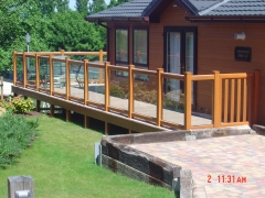 Golden Oak UPVC balustrade with glass panerls