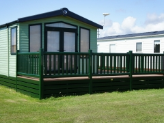 Green holiday home decking steps park estate lodge installers suppliers manufacturers sundecks vinyl plastic skirting deck board pvc upvc extrusion polymer composite wpc wood free galvanised steel sub-frame