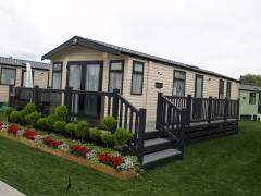 Fensys decking on Swift Burgundy holiday home caravan deck lodge skirting anthracite gayle grey upvc plastic installation lawns show