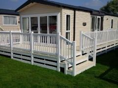 Fensys decking on Swift Chamonix holiday home caravan deck board installation upvc plastic lodge park estate vinyl sundeck
