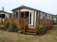 Holiday home deck golden oak & antique oak swift lodge park sundeck plastic decking upvc pvc balustrade hand rail low maintenance
