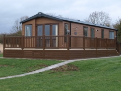 Holiday home decking rustic oak & cream holiday home decking steps park estate lodge installers suppliers manufacturers sundecks vinyl plastic skirting deck board pvc upvc extrusion polymer composite wpc wood free galvanised steel sub-frame