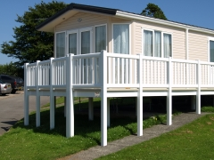 Tall elevated UPVC deck on holiday home