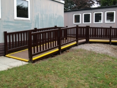 Composite school deck with ramp access disabled Holiday home decking gayle grey & charcoal composite wpc wood free decking deck board plastic upvc lodge park sundeck vinyl extrusion manufacturer