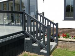 Plastic garden deck gayle grey, glass & driftwood holiday home decking steps park estate lodge installers suppliers manufacturers sundecks vinyl plastic skirting deck board pvc upvc extrusion polymer composite wpc wood free galvanised steel sub-frame
