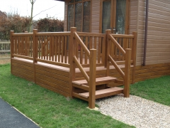 Holiday home decking golden oak & cedar holiday home decking steps park estate lodge installers suppliers manufacturers sundecks vinyl plastic skirting deck board pvc upvc extrusion polymer composite wpc wood free galvanised steel sub-frame