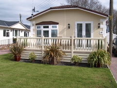 Holiday home decking cream bowed pickets holiday home decking steps park estate lodge installers suppliers manufacturers sundecks vinyl plastic skirting deck board pvc upvc extrusion polymer composite wpc wood free galvanised steel sub-frame