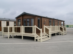 Holiday home decking cream, bronze glass & tawny holiday home decking steps park estate lodge installers suppliers manufacturers sundecks vinyl plastic skirting deck board pvc upvc extrusion polymer composite wpc wood free galvanised steel sub-frame