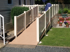 Cream & cedar ramp disabled access for Holiday home decking gayle grey & charcoal composite wpc wood free decking deck board plastic upvc lodge park sundeck vinyl extrusion manufacturer