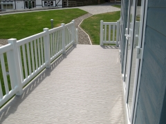 Holiday home decking white & stone holiday home decking steps park estate lodge installers suppliers manufacturers sundecks vinyl plastic skirting deck board pvc upvc extrusion polymer composite wpc wood free galvanised steel sub-frame