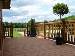 Holiday home decking gayle grey & charcoal composite wpc wood free decking deck board plastic upvc lodge park sundeck vinyl extrusion manufacturer