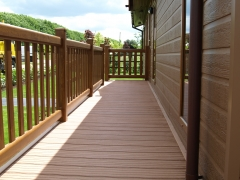 Holiday home decking golden oak & cedar composite wpc wood free decking deck board plastic upvc lodge park sundeck vinyl extrusion manufacturer