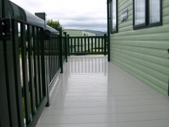 Green and Beige Fensys Holiday home decking beige deck board holiday home decking steps park estate lodge installers suppliers manufacturers sundecks vinyl plastic skirting deck board pvc upvc extrusion polymer composite wpc wood free galvanised steel sub-frame