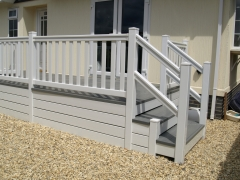 Fensys plastic UPVC decking in white and driftwood on park home lodge caravan deck board