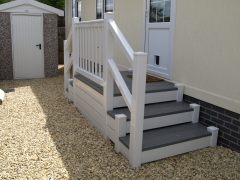 Fensys plastic decking with galvanised sub-frame holiday home decking steps park estate lodge installers suppliers manufacturers sundecks vinyl plastic skirting deck board pvc upvc extrusion polymer composite wpc wood free galvanised steel sub-frame
