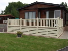 Holiday home decking cream holiday home decking steps park estate lodge installers suppliers manufacturers sundecks vinyl plastic skirting deck board pvc upvc extrusion polymer composite wpc wood free galvanised steel sub-frame