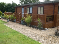 Fensys plastic decking in golden oak holiday home decking steps park estate lodge installers suppliers manufacturers sundecks vinyl plastic skirting deck board pvc upvc extrusion polymer composite wpc wood free galvanised steel sub-frame