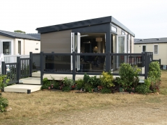 Holiday home decking gayle grey & cream holiday home decking steps park estate lodge installers suppliers manufacturers sundecks vinyl plastic skirting deck board pvc upvc extrusion polymer composite wpc wood free galvanised steel sub-frame