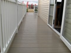 Holiday home decking white & tawny holiday home decking steps park estate lodge installers suppliers manufacturers sundecks vinyl plastic skirting deck board pvc upvc extrusion polymer composite wpc wood free galvanised steel sub-frame