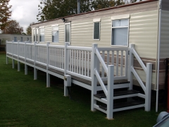Holiday caravan decking white & charcoal composite wpc deck board wood free upvc hand rail pvc plastic steps home park lodge sundeck veranda