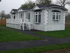 White & stone holiday home decking steps park estate lodge installers suppliers manufacturers sundecks vinyl plastic skirting deck board pvc upvc extrusion polymer composite wpc wood free galvanised steel sub-frame