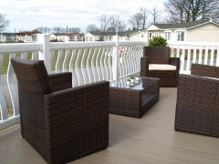 Sundeck deck white & tawny holiday home decking steps park estate lodge installers suppliers manufacturers sundecks vinyl plastic skirting deck board pvc upvc extrusion polymer composite wpc wood free galvanised steel sub-frame