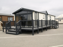 Holiday home decking gayle grey & driftwood holiday home decking steps park estate lodge installers suppliers manufacturers sundecks vinyl plastic skirting deck board pvc upvc extrusion polymer composite wpc wood free galvanised steel sub-frame