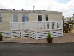 Holiday caravan decking white & tawny pvc upvc polymer manufacturer installer caravan park lodge home startford
