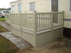 Plastic decking on caravan with solid UPVC skirting