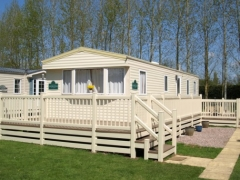 Upvc cream decking with skirting holiday home caravan sundeck pvc plastic deck board manufacturers extrusion park lodge estate installation