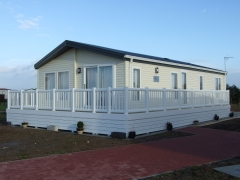 Holiday home decking white with ranch skirting lodge park home holiday estate plastic pvc upvc vinyl sundeck manufacturer extrusion