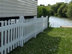 white caravan park plastic fence.JPG