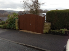 Fensys UPVC foiled Rustic Oak driveway gates
