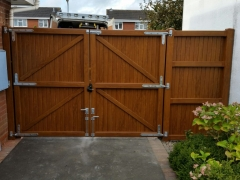 double upvc plastic gates and side panelin golden oak with galvanised hardware