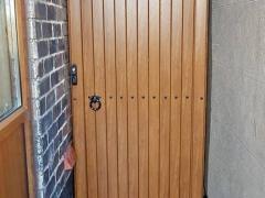 front of side entry single gate upvc golden oak foiled upvc plastic garden access