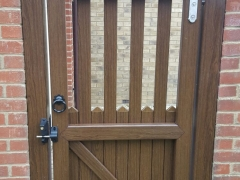 rear of fensys stanley gate with clear view in rustic oak upvc plastic back garden