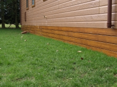 Golden oak ranch skirting on holiday home upvc plastic