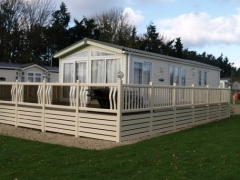 Cream ranch skirting upvc plastic fitted to holiday home decking