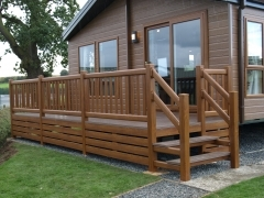 Lodge unit holiday home deck skirting in golden oak